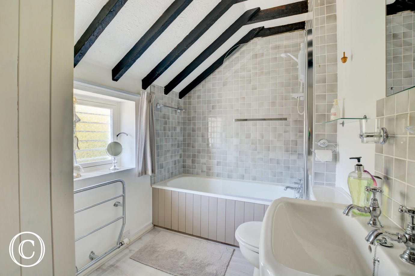 Bathroom with bath, washbasin and wc