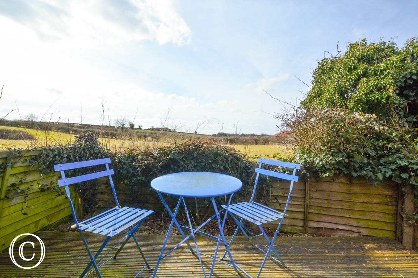 Decking area with garden furniture and countryside views