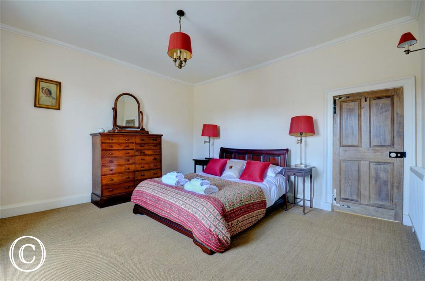 Spacious bedroom with king sized sleigh bed