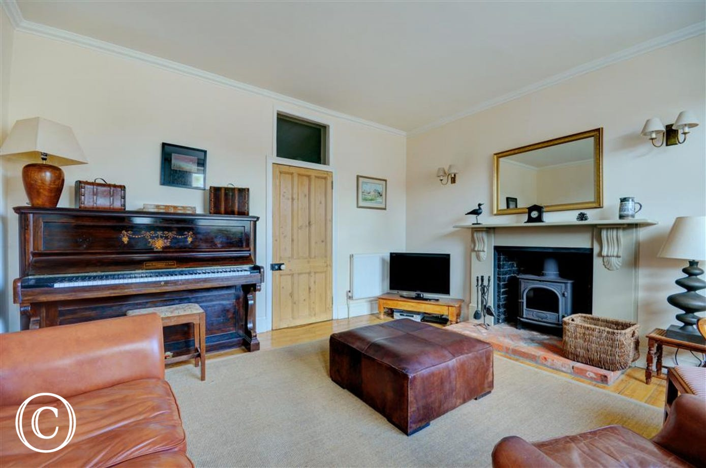 Cosy sitting room with woodburner