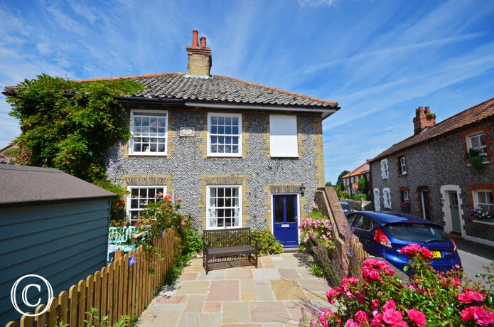An attractive brick and flint semi detached cottage.