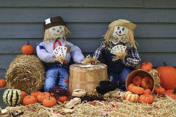 Two scarecrows sitting down