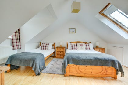 This bedroom has both a double bed and single bed