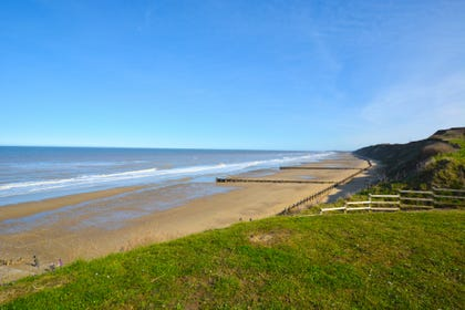 Children will love to play on Mundesley's golden sands.