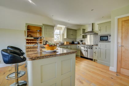 Lovely contemporary kitchen with most major appliances including a range cooker and an utility room