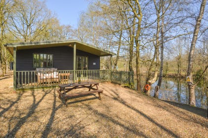 Marriotts Lodge is one of two detached lakeside lodges in a secluded fully enclosed setting comprising of a two acre lake surrounded by around three acres of tree-lined pathways/drive and picnic area.