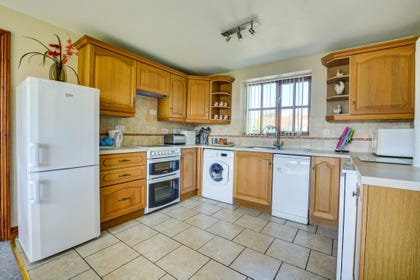 The kitchen features an electric cooker, fridge/freezer, microwave, washer/dryer, dishwasher.