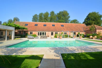 This property has the added luxury of access to this swimming pool