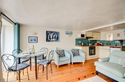 Living area with comfortable seating, and dining table and chairs
