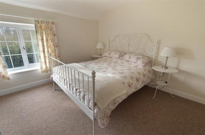 Pretty bedlinen and matching curtains in this spacious and light double room.