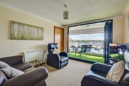 Sitting Area with bifold doors to balcony and marina views