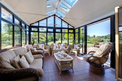 Conservatory with plenty of comfortable seating