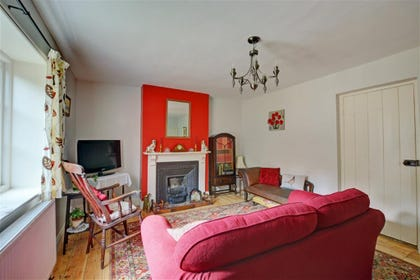 Sitting room with comfy seating and woodburner