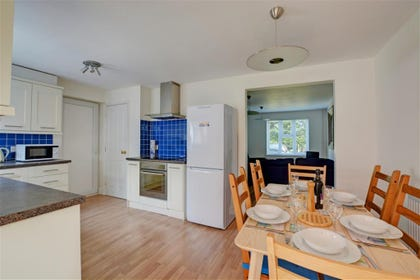 Spacious kitchen with table and chairs