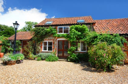 A lovely clematis clad brick and flint cottage in lovely countryside and close to the coast.
