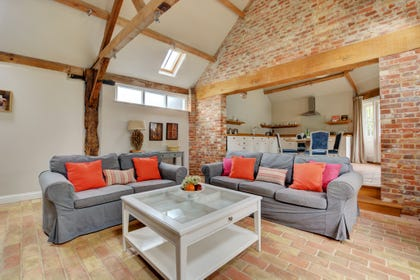 Open Plan Living Room with exposed beams and brickwork