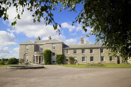 Hoveton Hall is a stately early 19th century house surrounded by extensive parkland