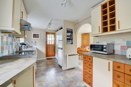 Traditional kitchen with all the major appliances and and a stable door overlooking the patio