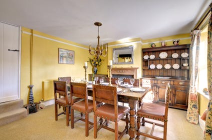 Dining room with table set for eight