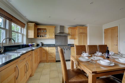 The lovely kitchen/dining room is on the first floor. There are fitted wooden units and a stainless steel range cooker.