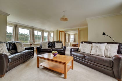 Sitting room two has comfortable leather settees and there are views over the open countryside. Double glazed doors open through to a second sitting room