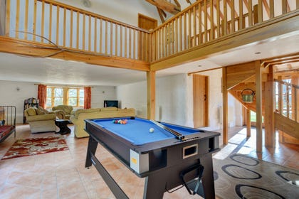 The hall at the centre of the open plan ground floor is home to a pool table which will be popular with everyone in the party
