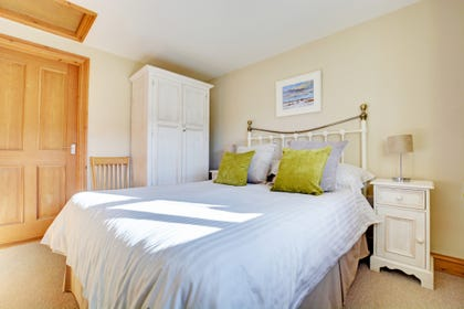 Elegant double bedroom with double bed, stylishly decorated.