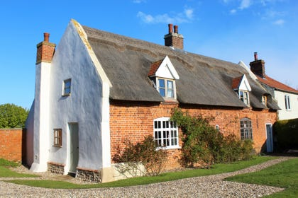 The cottage is a delightful, 1700s thatched cottage with a large garden leading onto open fields and within easy walking distance of the beach