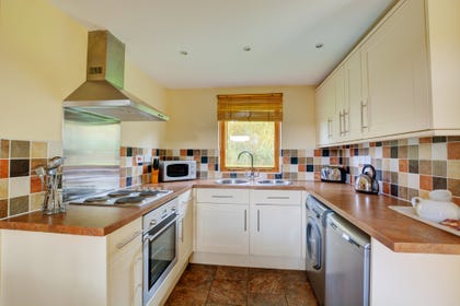 The well-fitted and equipped kitchen has lots of worktop space.