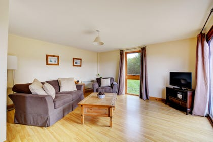 The spacious sitting room is comfortably furnished.