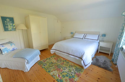 Bedroom two is a spacious room with a king sized bed