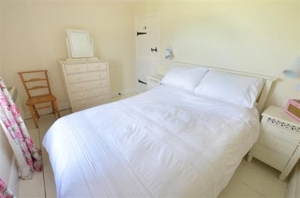Double bed in this beautifully furnished main bedroom