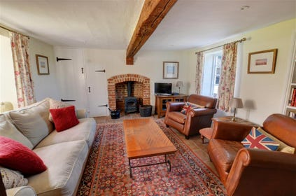 Another view of the sitting room showing the woodburner