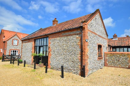 Attractive brick and flint barn