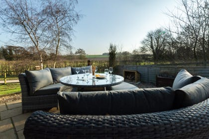 Patio area with comfortable rattan sofas & table