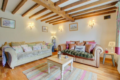 Comfortable seating in this delightfully cosy sitting room