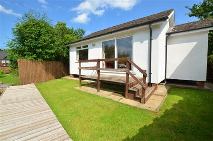 This is a rear exterior image of this charming lodge on the Norfolk Broads