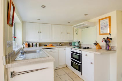 Lovely, bright and modern kitchen with all the major appliances, well equipped for preparing family meals