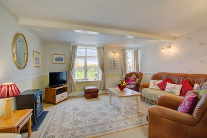 Traditionally furnished and spacious sitting room with lots of light and plenty of room for all the family