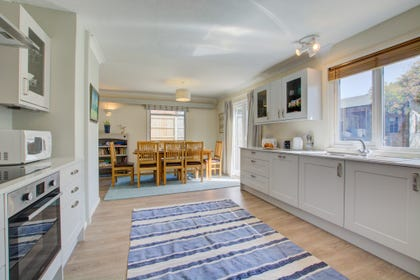 The modern kitchen is adjacent to the dining area for maximum convenience.