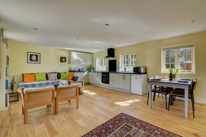 Spacious open plan Living/Dining Area, with comfortable seating, table and chairs