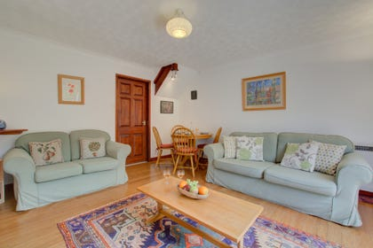 Spacious and light, there is a dining table and chairs, perfect for family meals