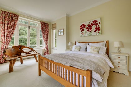 Lovely spacious double bedroom with a king-size bed