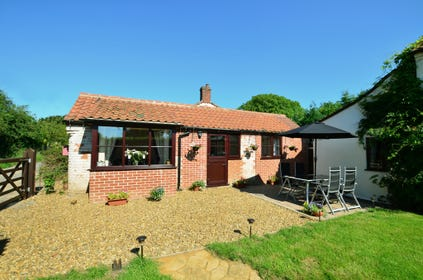 Holly Cottage stands at the front of the owner's home; the property has recently been refurbished and offers cosy, comfortable accommodation on one level. Fully enclosed garden with lawn, patio, barbecue, table and chairs