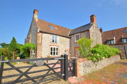 The traditional brick and flint farmhouse, built originally in the 1700s is full of character, has quirky features and a magnificent inglenook fireplace which is listed and described in Pevsner's Buildings of Norfolk.
