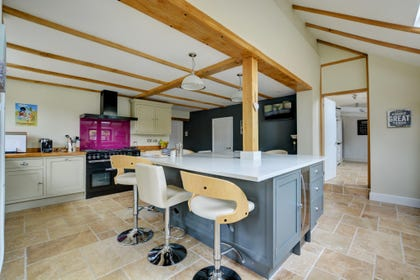 Large kitchen with breakfast island and stools