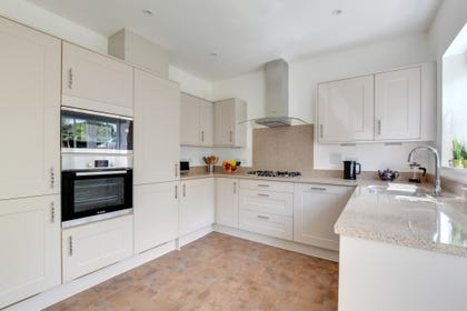 Fitted kitchen with built in oven