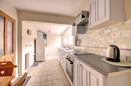 Kitchen with electric oven, electric hob, fridge, dishwasher, washing machine, tumble dryer