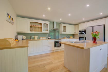 Fabulous kitchen with American-style fridge freezer and island unit.