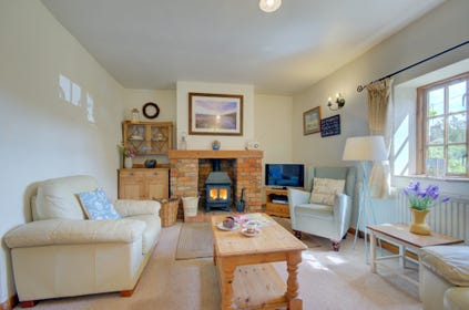 This property has a delightful cosy sitting room with woodburner
